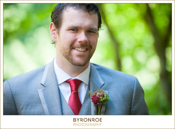 groom boutonniere sophisticated floral red masala color
