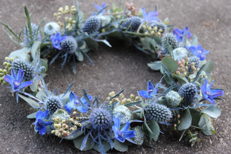 blue floral crown with delphinium and eryngium