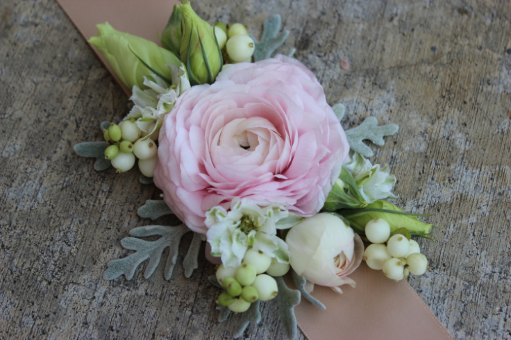 Modern wrist corsages for weddings and special occasions blush pink ranunculus wrist corage with ribbon mightylinksfo