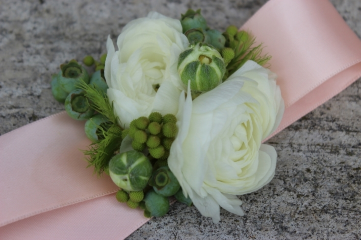 peach and white blueberry wrist corsage with ranunculus