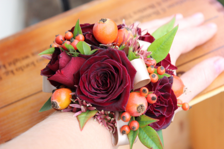 red orange fall colored wrist corsage