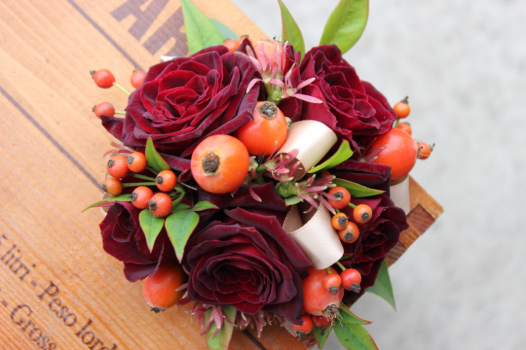 fall roses wrist corsage with roses and berries