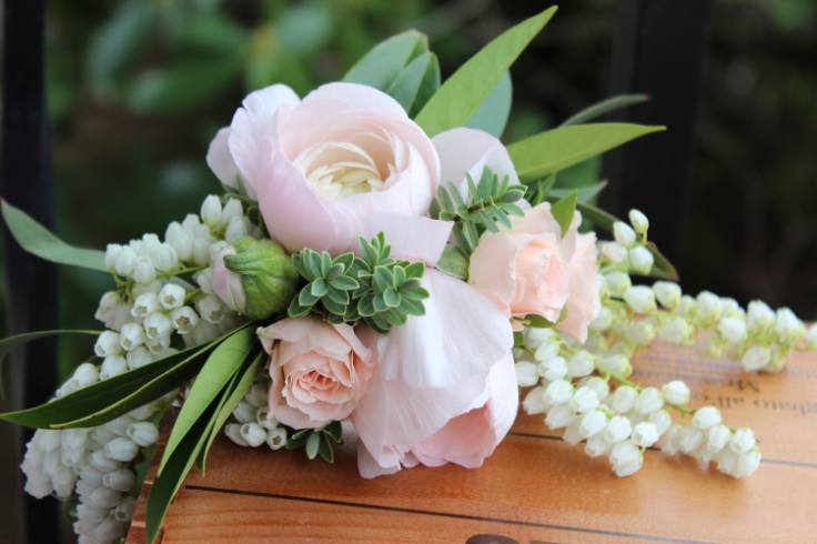 blush pink floral crown with pieris ranunculus and spray roses