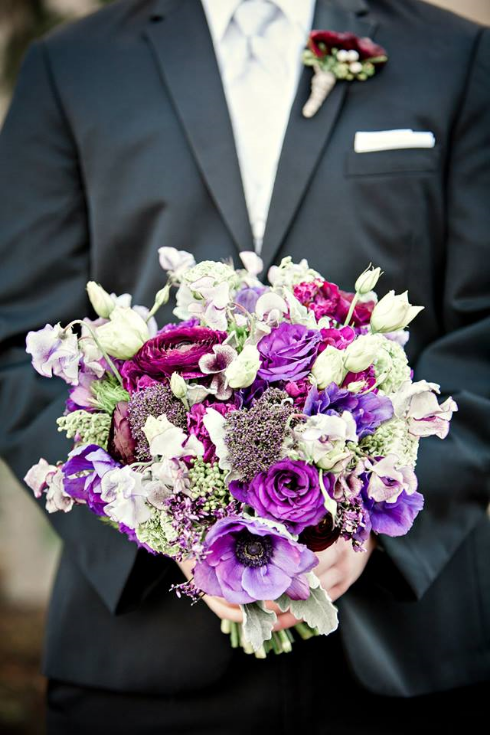 groom holding bouquet sophisticated floral purple bridal bouquet