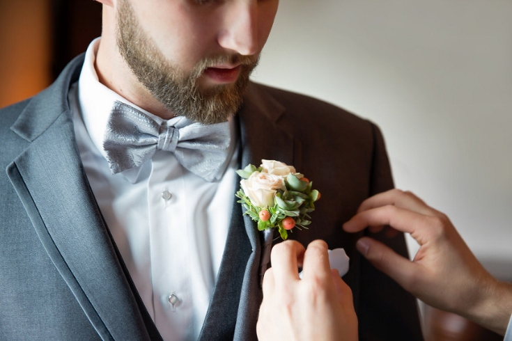 groom and boutonniere sophisticated floral