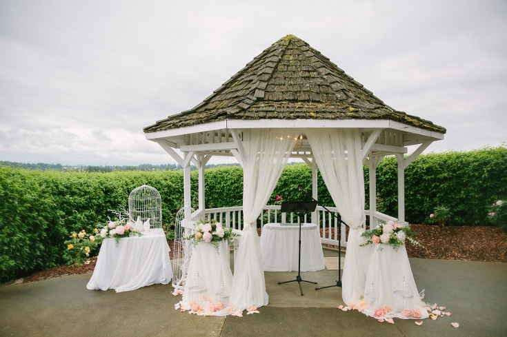 wedding ceremony set up gazebo arbor drape bird cages sophisticated floral