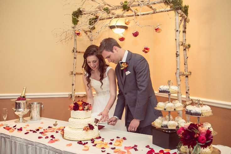 cake cutting arbor decor flowers sophisticated floral
