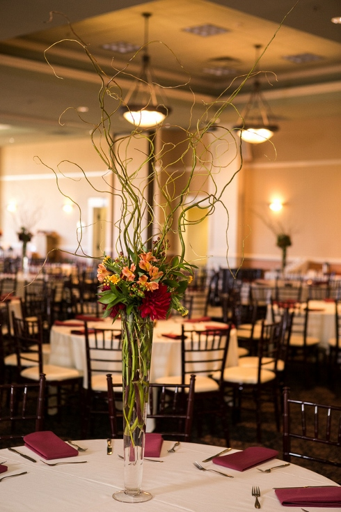 sophisticated floral tall glass vase centerpiece dahlia fall arrangement with curly willow branches pilsner vase