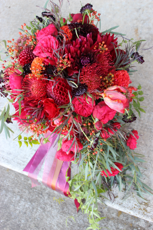 lush bridal bouquet fall colors red orange sophisticated floral designs portland oregon wedding florist