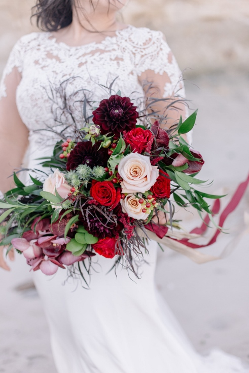 gold and red bridal bouquet wedding flowers sophisticated floral