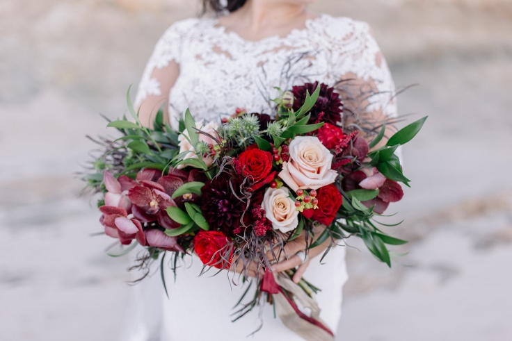red wedding bouquet with dahlia roses and vanda orchids sophisticated floral designs