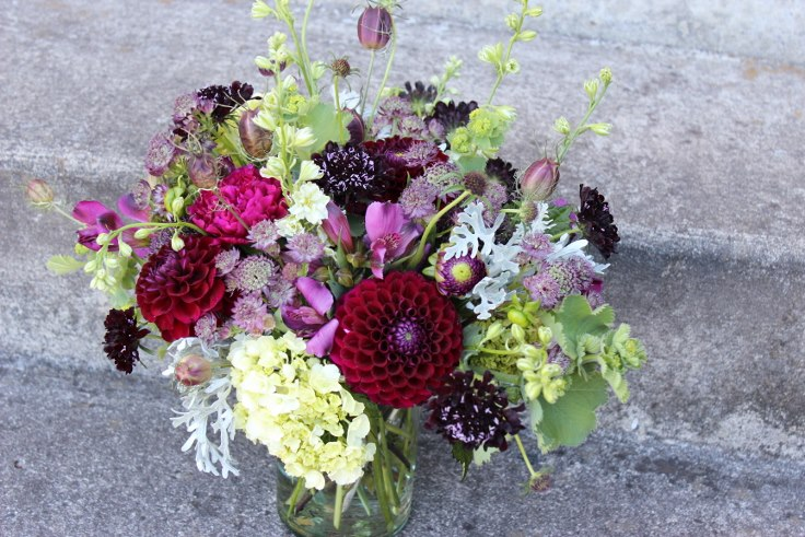 sophisticated floral centerpieces with dahlia and scabiosa nigella hydrange lady mantle portland florist