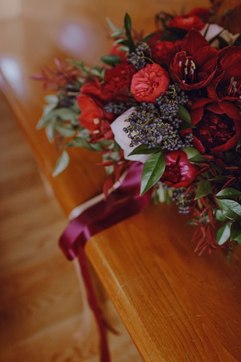 dark and moody bridal bouquet with poeny and amaryllis