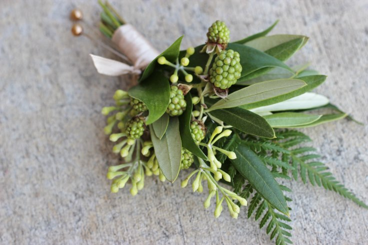 sophisticated floral designs portland oregon florist fern boutonniere with berries