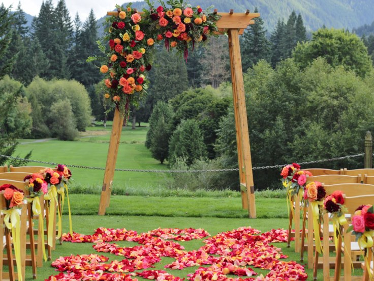 sophistiated floral designs portland oregon wedding florist the resort at the mountain wedding asymmentrical arbor flowers arch flowers rose petal aisle swirl design