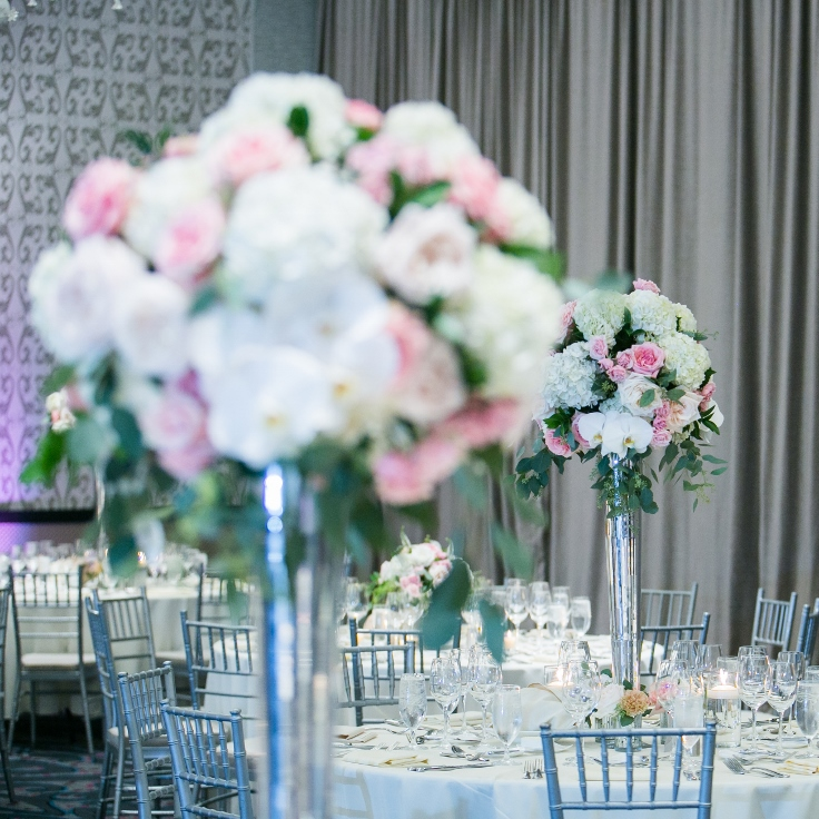sophisticated floral designs portland oregon wedding florist Nines Hotel tall elevated centerpieces in silver vases