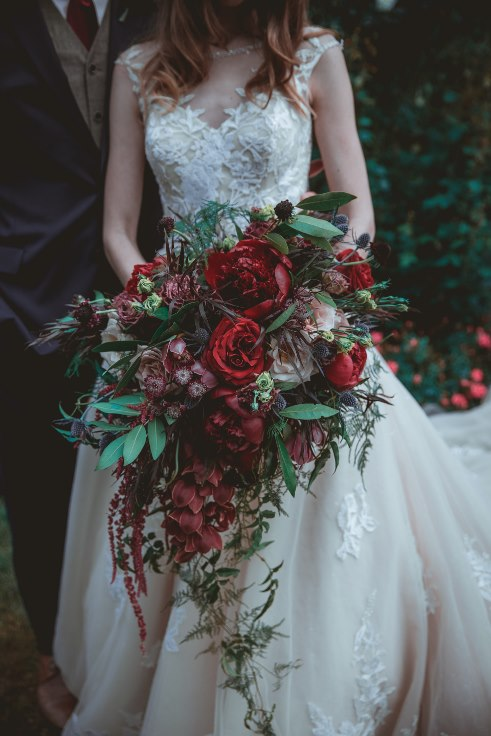 sophisticated floral designs portland oregon wedding florist bridal bouquet garden style oversized organic cascade bouquet dark and moody wedding flowers