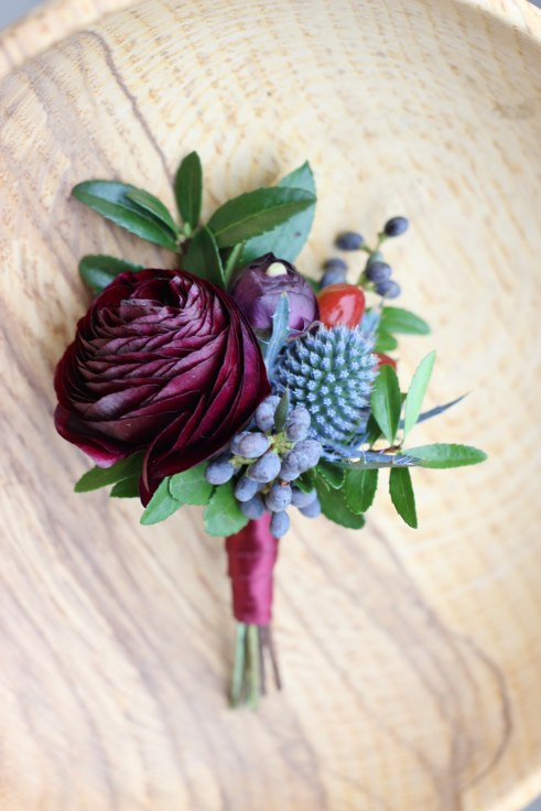 sophisticated floral designs portland oregon wedding florist plum aand navy boutonniere ranunculus