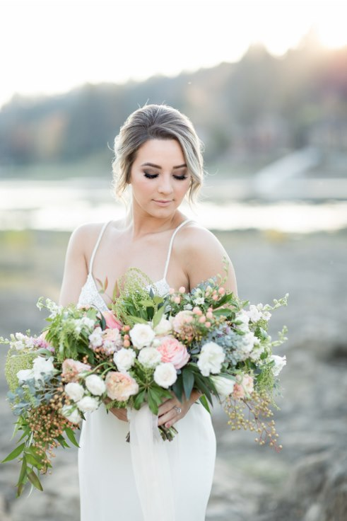 sophisticated floral designs portland oregon wedding florist blush oversized boho bridal bouquet ranunculus garden roses (1).jpg