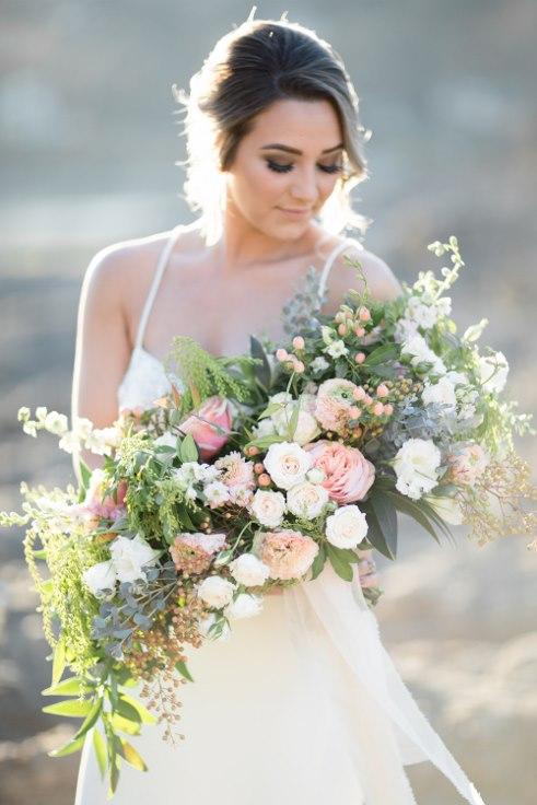sophisticated floral designs portland oregon wedding florist blush oversized boho bridal bouquet ranunculus garden roses (3).jpg