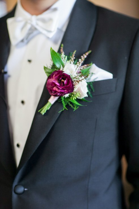 sophisticated floral designs portland oregon wedding florist sentinel hotel george street photo bridal bliss wedding planning plum ranunculus and blushiung bride protea boutonniere
