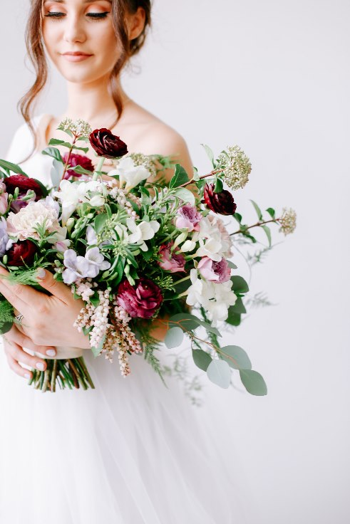 sophisticated floral designs portland oregon wedding florist spotted stills photography plum ranunculus bouquet