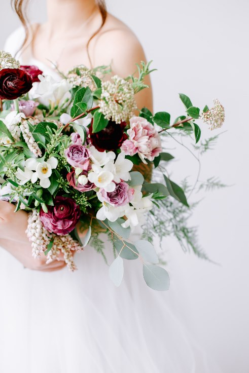 sophisticated floral designs portland oregon wedding florist spotted stills photography plum and mauve ranunculus bouquet (5).jpg