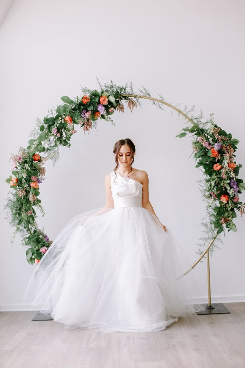 sophisticated floral designs portland oregon wedding florist floral hoop round arbor moon gate arch (12).jpg