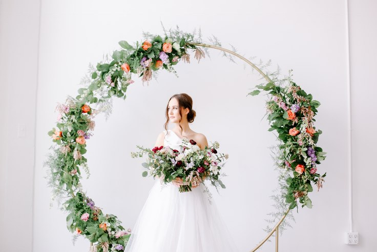 sophisticated floral designs portland oregon wedding florist floral hoop round arbor moon gate arch (15).jpg