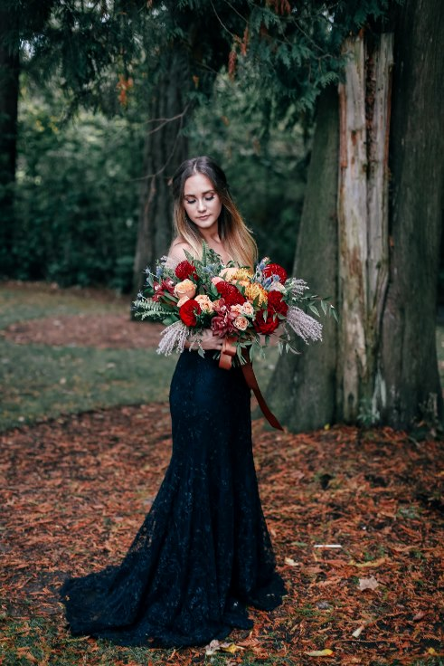 sophisticated floral designs portland oregon wedding florist spotted stills photography fall floral installation arbor flowers pampas grass