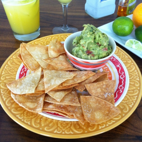 Easy homemade tortilla chips and guacamole from TooIntoIt.com