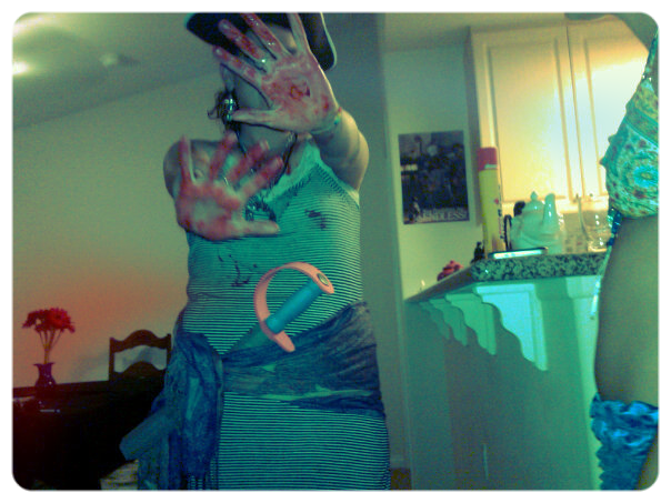"""Old picture of me at a Shark Week party in 2010. I had huge """"Shark Bites"""" on my arms and chest and lots of fake blood."""