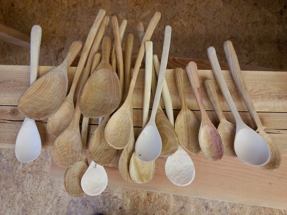 I've been busy making spoons. Got into a nice piece of cherry. There is one spoon carved out of plum and a few out of birch. Carving over and over, learning what works. These are all rough carved and are drying to be finish carved or sanded. The birch ones will get painted handles.