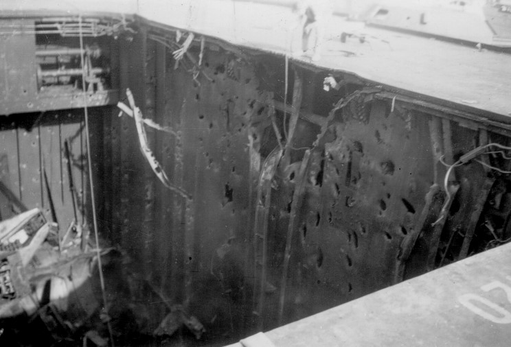 Bullseye ... no less than three bombs entered Illustrious' aft lift well. This picture shows the detonation point of one of these bombs high on the port side.