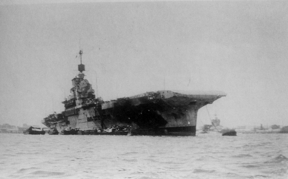 "Gaping wound ... the blackened void where the side of HMS Formidable was blown out in front and underneath of ""A"" 4.5in turret sponson is evident in this picture taken shortly after her return to Alexandria Harbour."