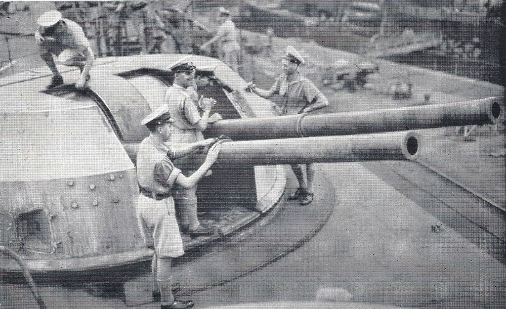 HMS Formidable's crew look over a 4.5in gun turret during HMS Formidable's stay in Norfolk Naval Yards, United States.