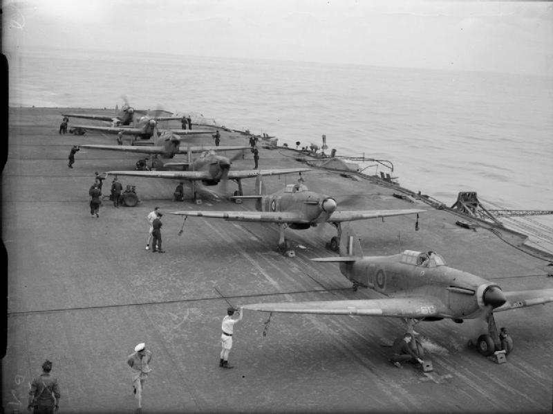 Six Hawker Sea Hurricanes of 885 Squadron, Fleet Air Arm with their engines running, ranged on the deck of HMS VICTORIOUS. All are ready to take off the moment an enemy aircraft is spotted.