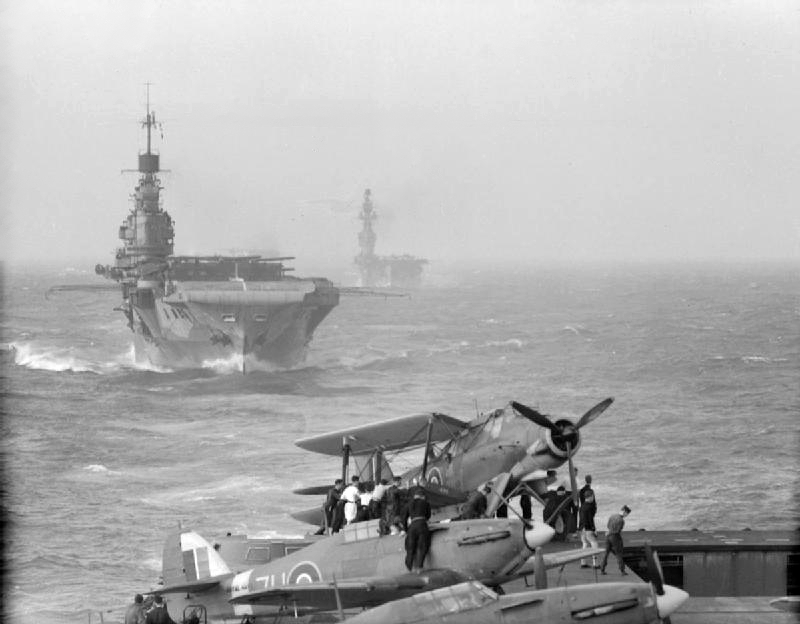 Preliminary movements: 3 - 10 August 1942: Photograph taken from the after end of VICTORIOUS' flight deck showing HMS INDOMITABLE and EAGLE. A Hawker Sea Hurricane and a Fairey Albacore are ranged on VICTORIOUS' flight deck.