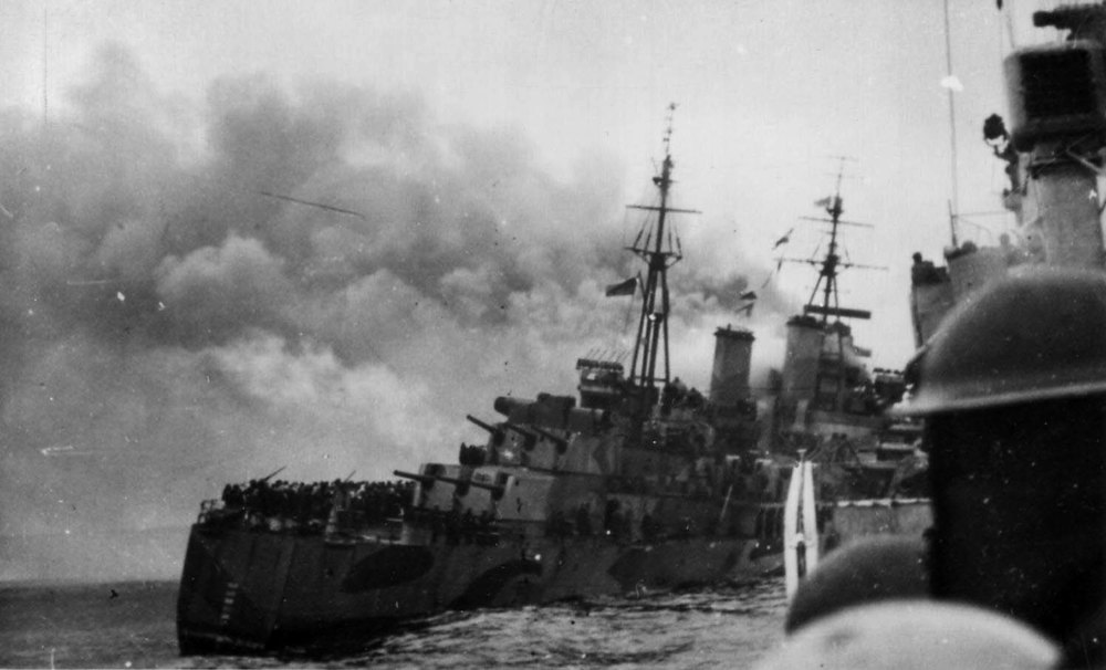 A destroyer comes alongside HMS NIGERIA after the cruiser was torpedoed on August 12.
