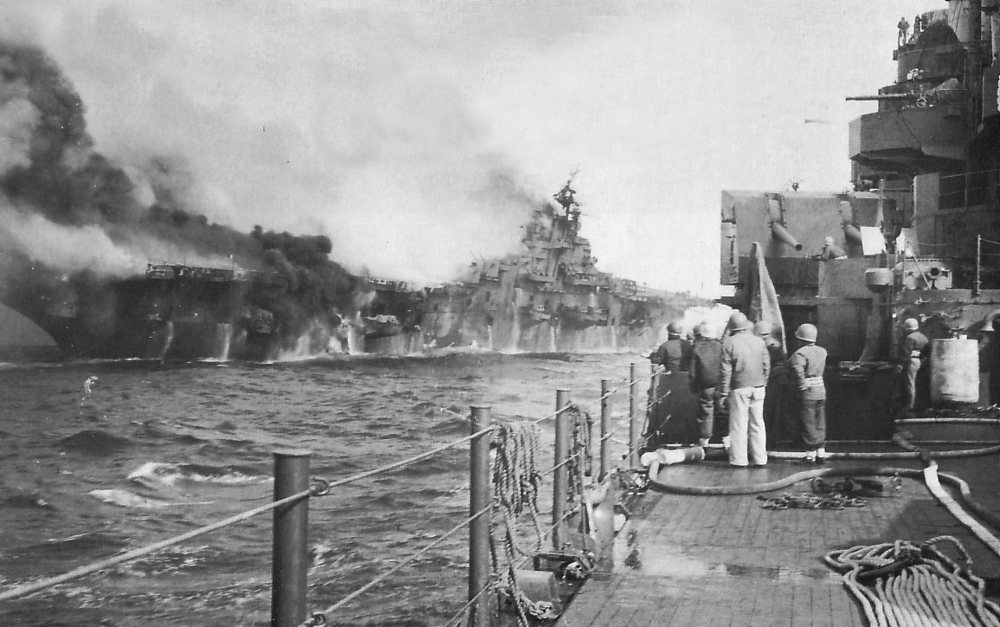 USS Franklin burns after being hit by one, and possibly a second partially detonated, 250kg (500lb) bomb.
