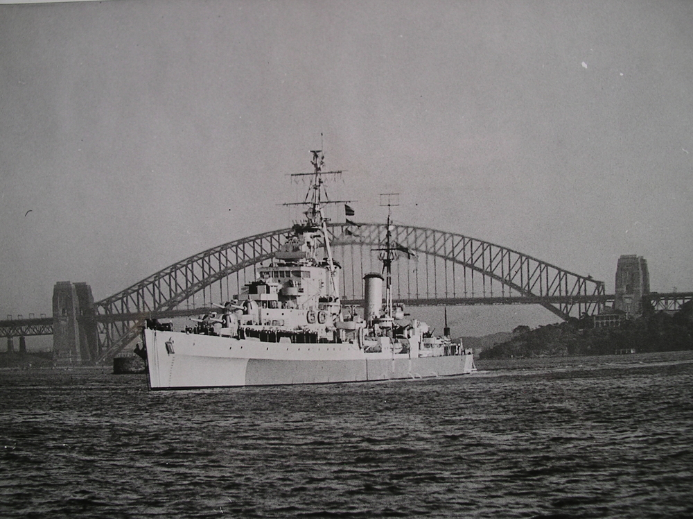 HMS Argonaut at anchor in Sydney Harbor, 1945.