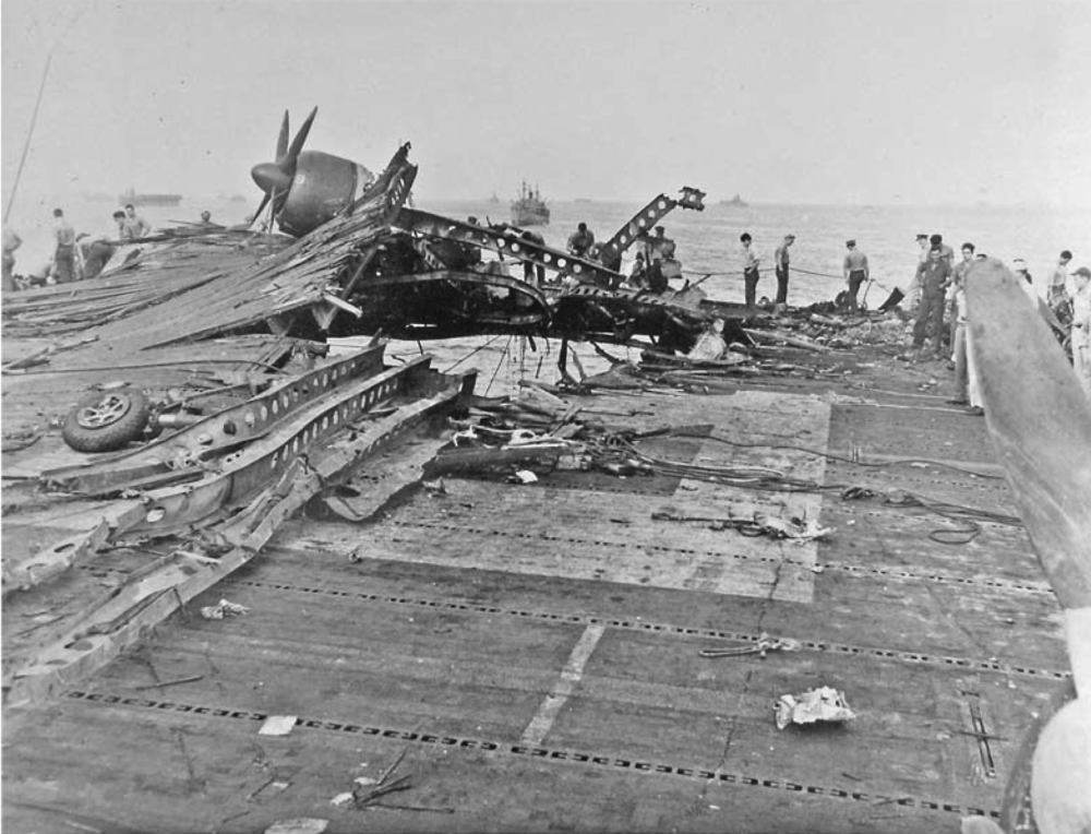 The hole in the aft section of USS Randolph's flight deck after a kamikaze attack in Ulithi harbour.