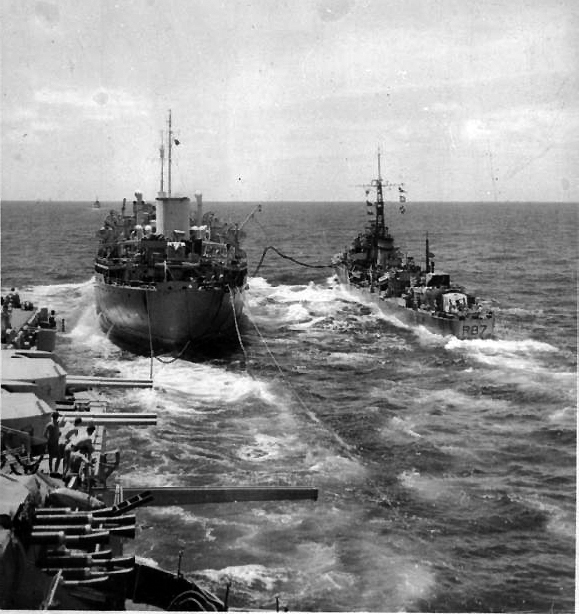 "Royal Fleet Auxiliary Empire Salvage refuels HMS Whirlwind and HMS Illustrious. Note the unoccupied ""outrigger"" pylon between the Pom Pom mounts and the 4.5in turrets."