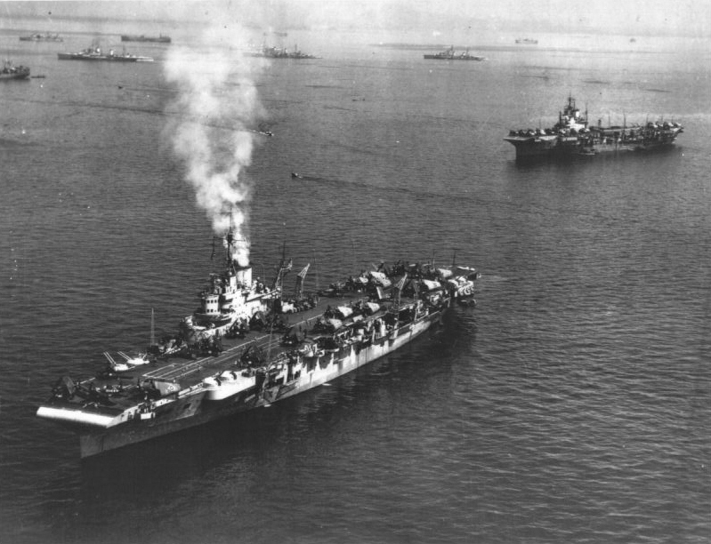 HMS FORMIDABLE is in the foreground of this picture of BPF carriers and cruisers anchored at Leyte.