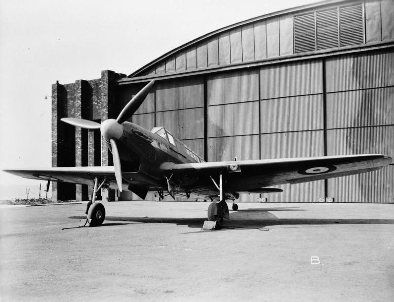 An early Fairey Fulmar on display outside its hangar.