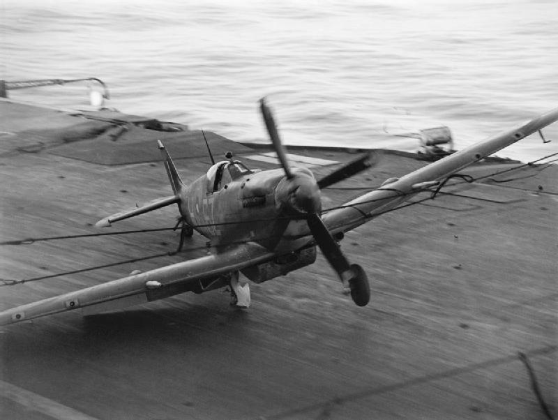 A Supermarine Seafire hits the barrier on HMS INDEFATIGABLE after returning from a strike on the Japanese oil refinery at Pangkalan Brandan, Sumatra..