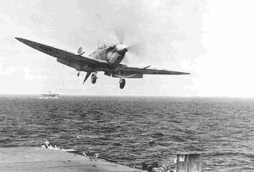 A Seafire goes around again after a failed approach on HMS HUNTER'S flight deck.