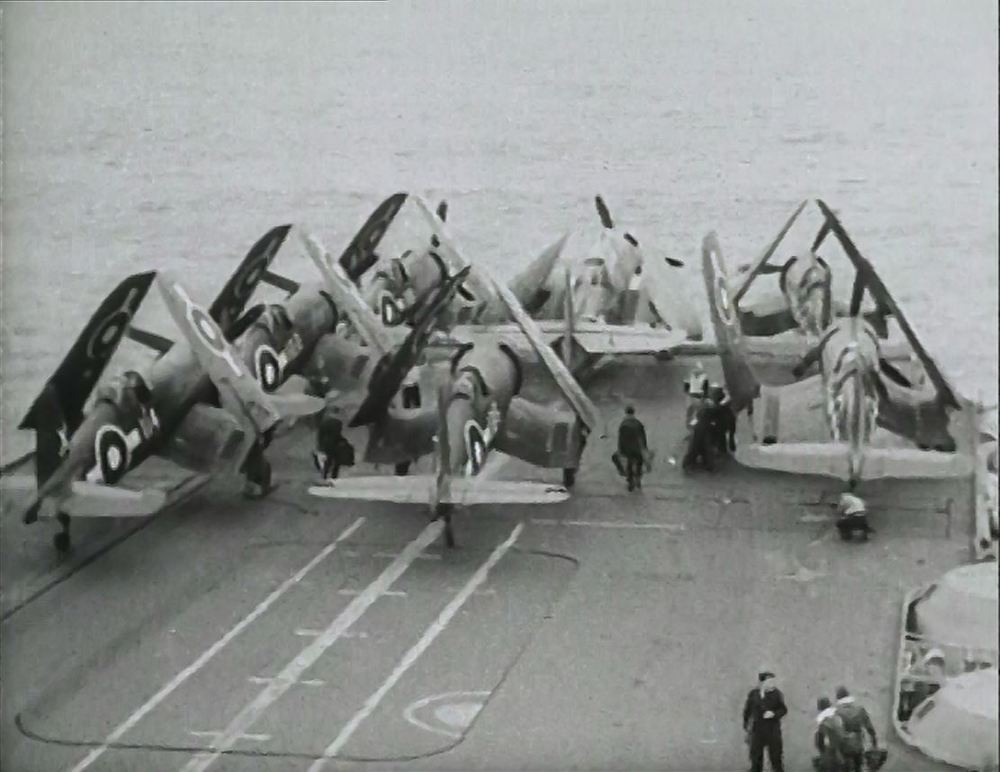 Corsairs and Avengers are stowed forward as a strike returns to the deck of HMS FORMIDABLE.