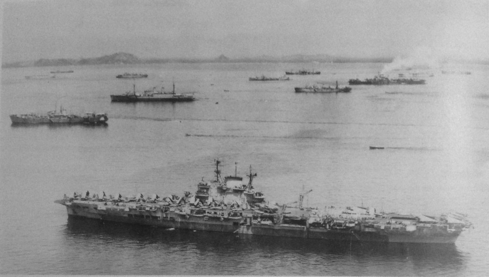 One of only a very few images of the BPF anchored at Manus. HMS VICTORIOUS in the foreground, with elements of the Fleet Train and possibly HMS INDEFATIGABLE in the background.