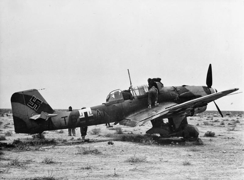 British troops inspect a Junkers Ju 87 Stuka which made an emergency landing in the desert, December 1941.